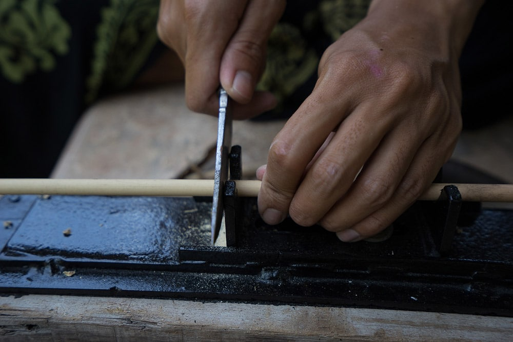 Each straw is gently cut by Gitok to avoid breaking the bamboo