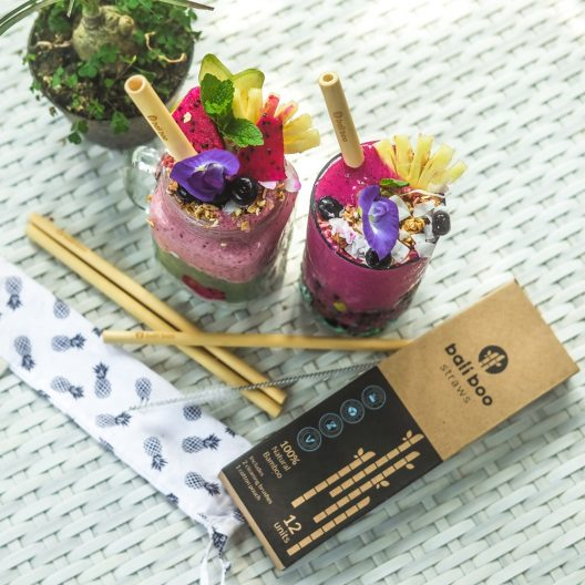 pack of bamboo straws with cleaning brush, and cotton pouch
