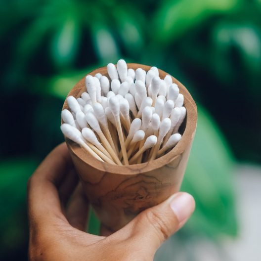 bamboo cotton swabs in a cup